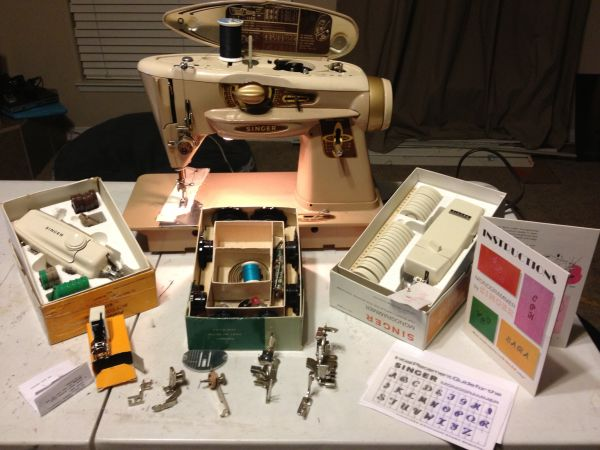 Singer rocket sewing machine slant-o-matic with lots of accessories  - $150 (Rosedale)