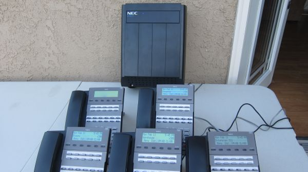 Nec DSX 80 phone system with voicemail caller ID and display phones  - $799 (oc)