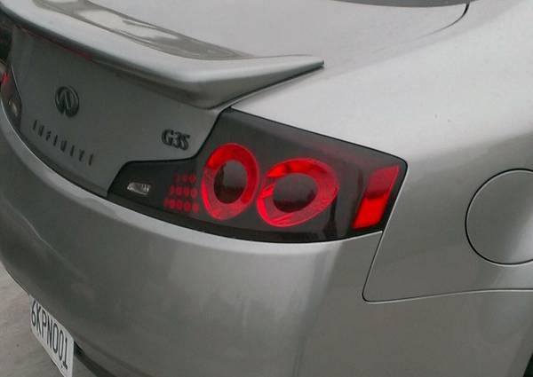 g35 coupe 06-07 tail light for trade  (LA )