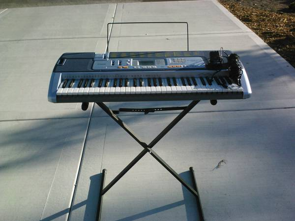 CASIO LK-110 Electric Keyboard w Stand - $110 (Reno)